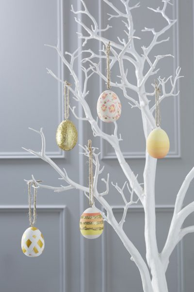 White branch serving as Easter Egg Tree