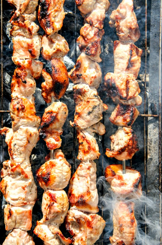 pork kebabs grilling to perfection on a charcoal grill