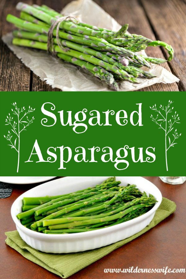 Fresh asparagus on a cutting board being trimmed to fit saute pan.