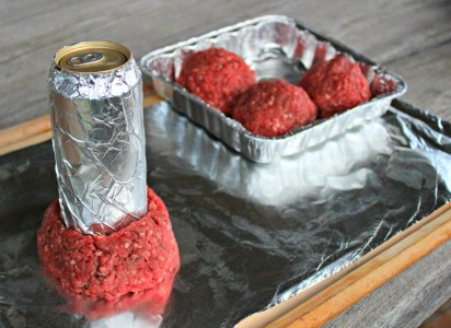 The hamburg must be shaped around a beer can wrapped in aluminum foil to make your Beer Can Burger