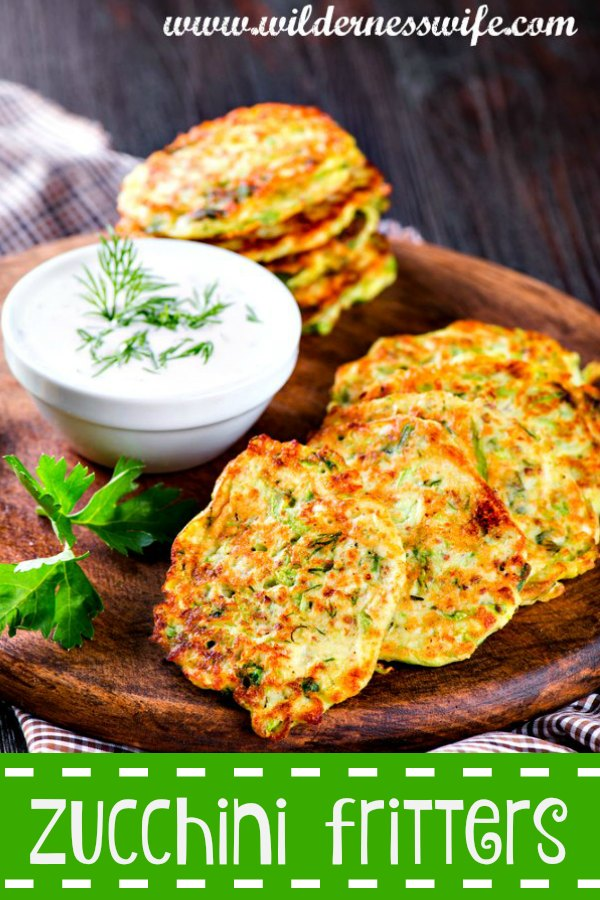 Delicious Zucchini Fritters Recipe drenched in a smooth Dill & Chive Sour Cream Sauce....yummy!