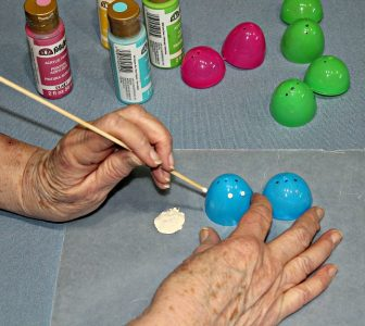 How to make an Easter Egg Tree - decorating the plastic Easter Eggs with acrylic paint and a dowel.