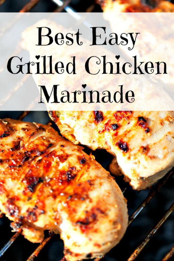 Marinated boneless chicken breasts on a gas grill cooking to grilled perfection