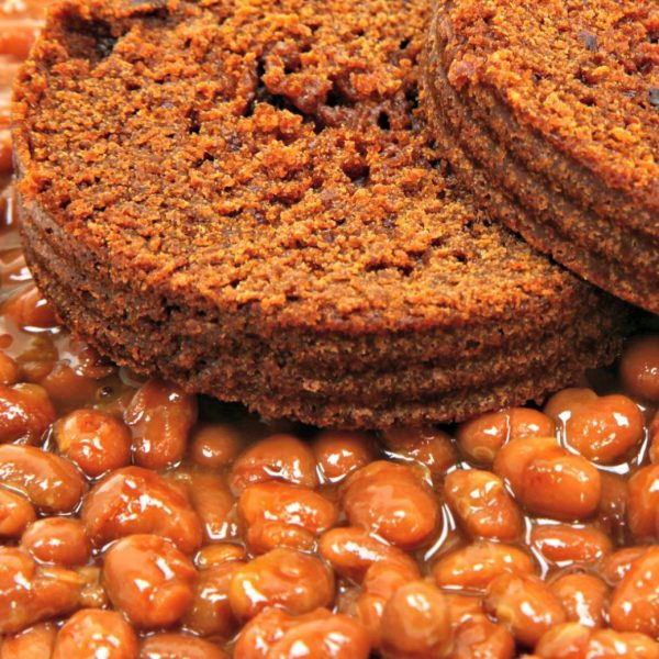 Plate of Boston Baked Beans served with homemade brown bread