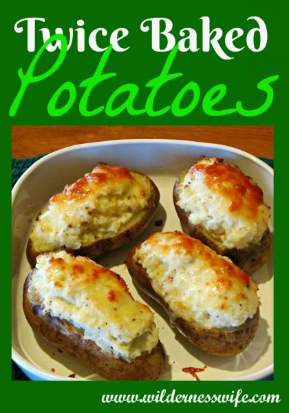 Twice baked potatoes in a Corningware roasting pan made from an easy twice baked potatoes recipe.