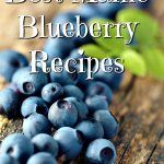 Luscious fresh Maine Blueberries on wood table top in rustic kitchen