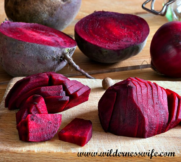 Sliced beets on a cutting board ready to be used in our Recipe
