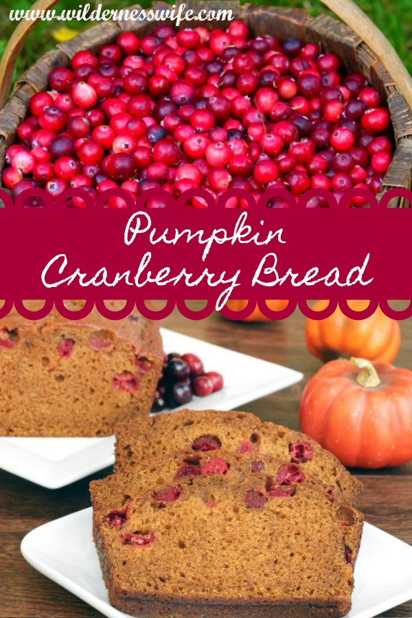 A basket of fresh cranberries and some slices of warm Pumpkin Cranberry Bread with mini pumpkins on a cutting board.