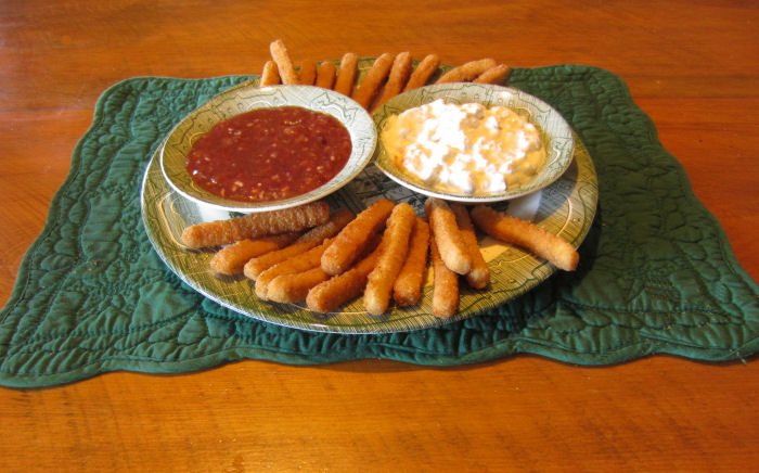 Two sauces - one savory and one sweet/sour served with Tyson Chicken Fries
