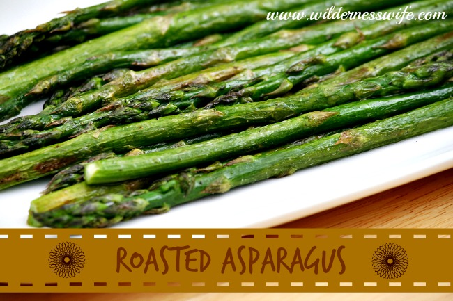 Easy roasted asparagus on a white plate.