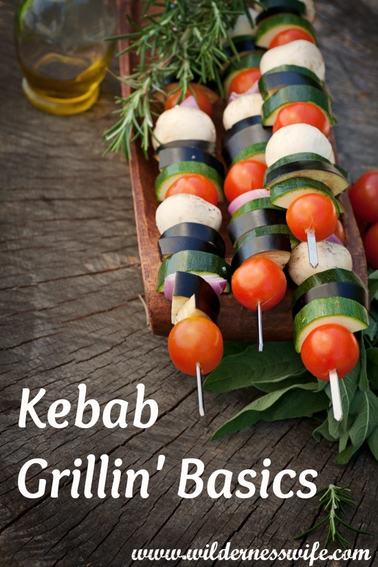 vegetable kebabs ready for the grill setting on a wooden table