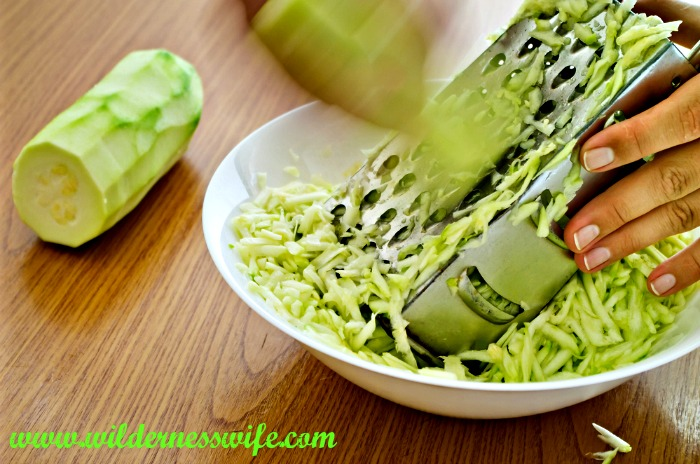 Grating zucchini for zucchini fritter with dill sauce recipe using a box grater - going old school.