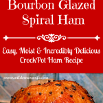 A beautiful mahogany colored baked spiral ham glazed with an orange Bourbon sauce