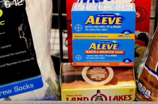 Walmart shopping cart showing my goto pain relief - Aleve