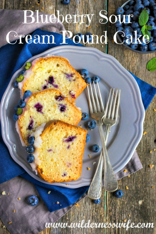 3 slices of Blueberry Sour Cream pound cake on a blue plate